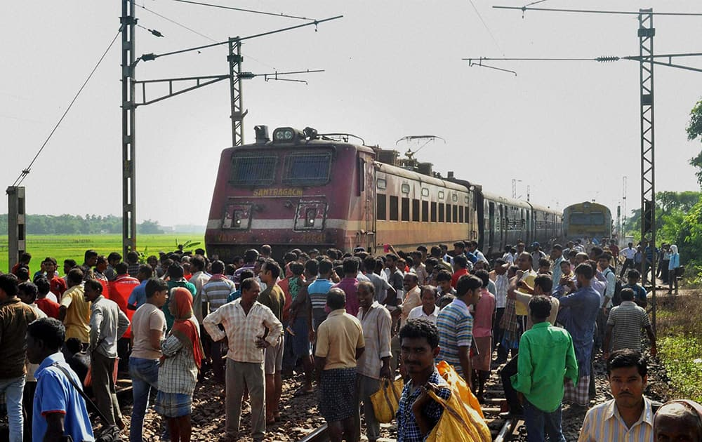 Local villagers block the railway tracks at Duan Station in West Midnapore district on Tuesday to press for their various demands.