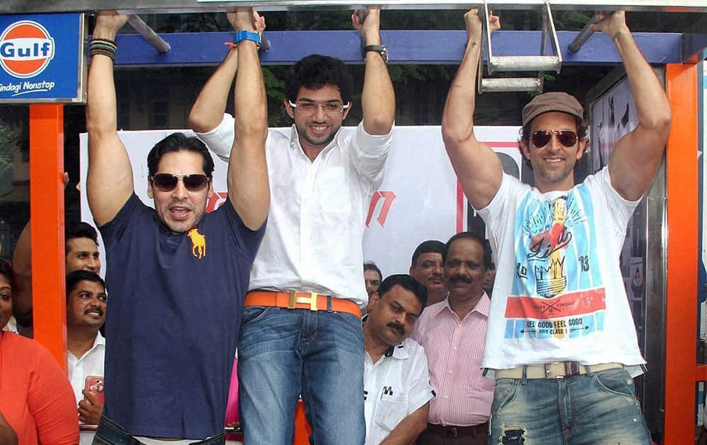 Dino Morea (L) Hrithik Roshan (R) and Shiv Sena Youth Wing Chief Aditya Thackeray (C) at the inauguration of DM Fitness studio in Mumbai.