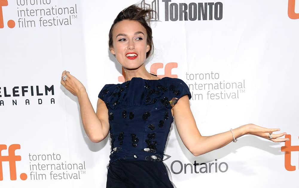 Actress Keira Knightley arrives in a wind storm to the premiere of `Laggies` at Roy Thomson Hall during the Toronto International Film Festival.