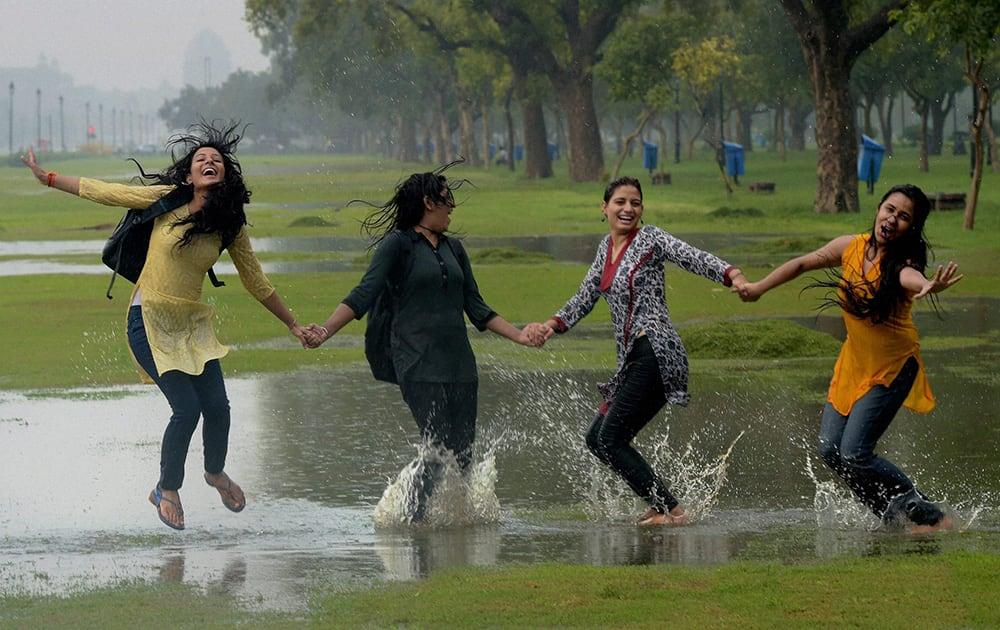 Young girls enjoying the rains at Rajpath in New delhi.