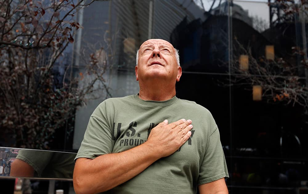 United States Navy veteran Richard Fill, of Easton, Penn., looks up at 1 World Trade Center during a moment of silence on the 13th anniversary of the Sept. 11, 2001 attacks in New York.