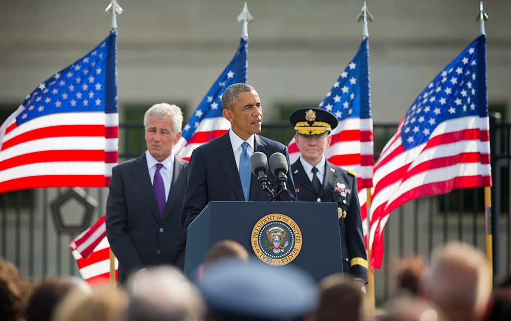 President Barack Obama, flanked by Defense Secretary Chuck Hagel, and Joint Chefs Chairman Gen. Martin Dempsey, speaks at the Pentagon, Thursday, Sept. 11, 2014, to mark the 13th anniversary of the 9/11 attacks.