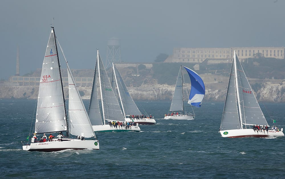 A number of boats make their way past Alcatraz Island in the fog during the 50th anniversary Rolex Big Boat Series sailing event, in San Francisco.
