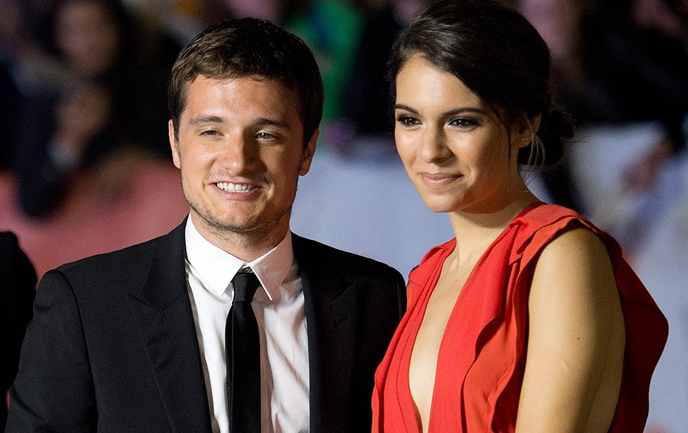 Actors Josh Hutcherson, left, and Claudia Traisac, pose for photographs on the red carpet for the new movie 'Escobar: Paradise Lost' during the 2014 Toronto International Film Festival in Toronto.