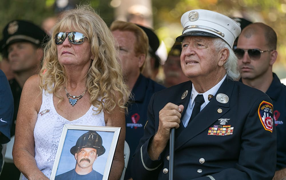 FDNY Rescue Co. 1 retired Lt. Paul Geidel, 82, right, with his wife, Barbara, attend a memorial ceremony marking the 13th anniversary of Sept. 11 terror attacks at the World Trade Center at the Los Angeles Fire Department Frank Hotchkin Memorial Training Center in Los Angeles.