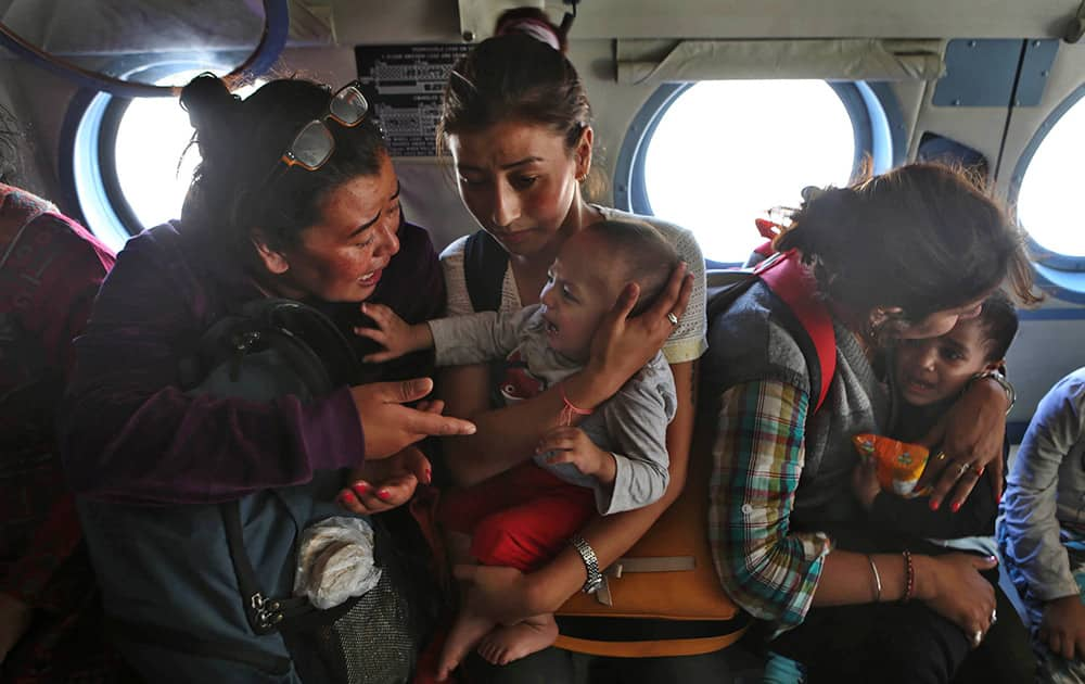 Tourists comfort their crying children inside an Indian air force helicopter after being rescued from a flooded neighborhood in Srinagar.