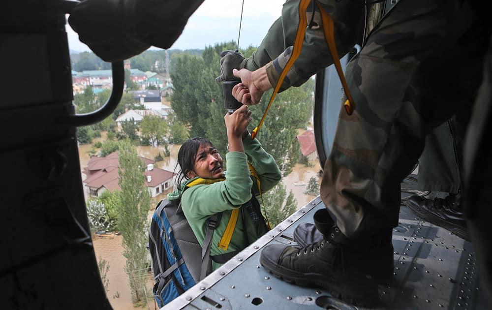 A tourist cries as she is airlifted by a chopper in Srinagar.