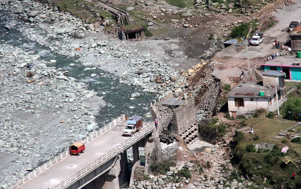 An aerial view of a bridge collapsed due to flash-floods in Kotranka tehsil of Rajouri district of Jammu and Kashmir.