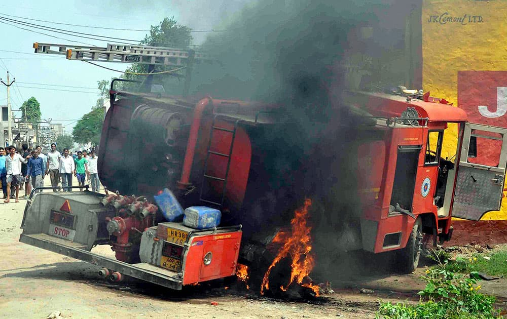 Angry mob burnt a fire brigade vehicle after the death of a school boy in Ballabgarh, Faridabad.