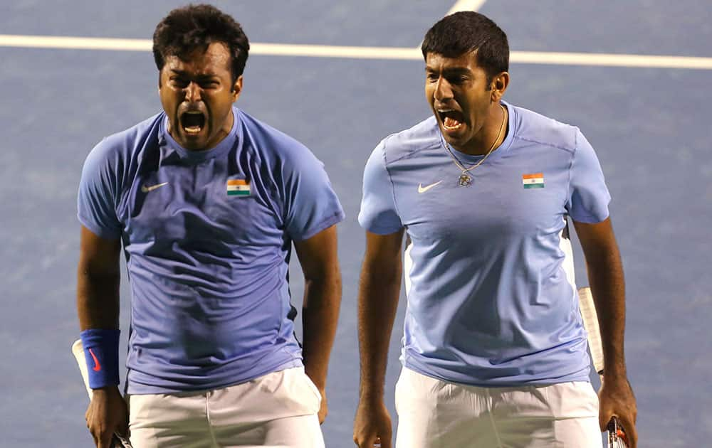 India's Leander Paes, left, and his partner Rohan Bopanna celebrate scoring a point against Serbia's Nenad Zimonjic and Ilija Bozoljac during their Davis Cup tennis World Group play-off tie between India and Serbia, in Bangalore.