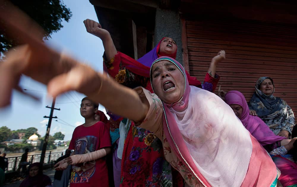 Kashmiri Muslim women wail at Ghulam Qadir's funeral procession after his body was retrieved under the rubble of his house that collapsed in floodwaters in Srinagar, India.