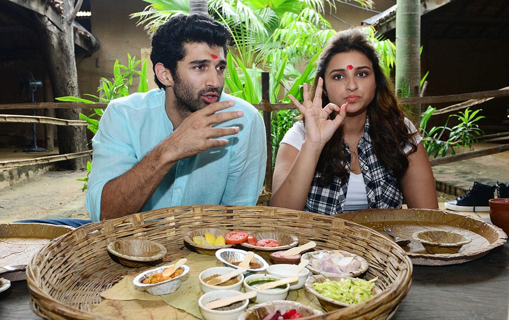 Bollywood actors Aditya Roy Kapoor and Pareeniti Chopra taking Gujarati lunch during a promotional event of their up coming movie Daawat-e-Ishq.