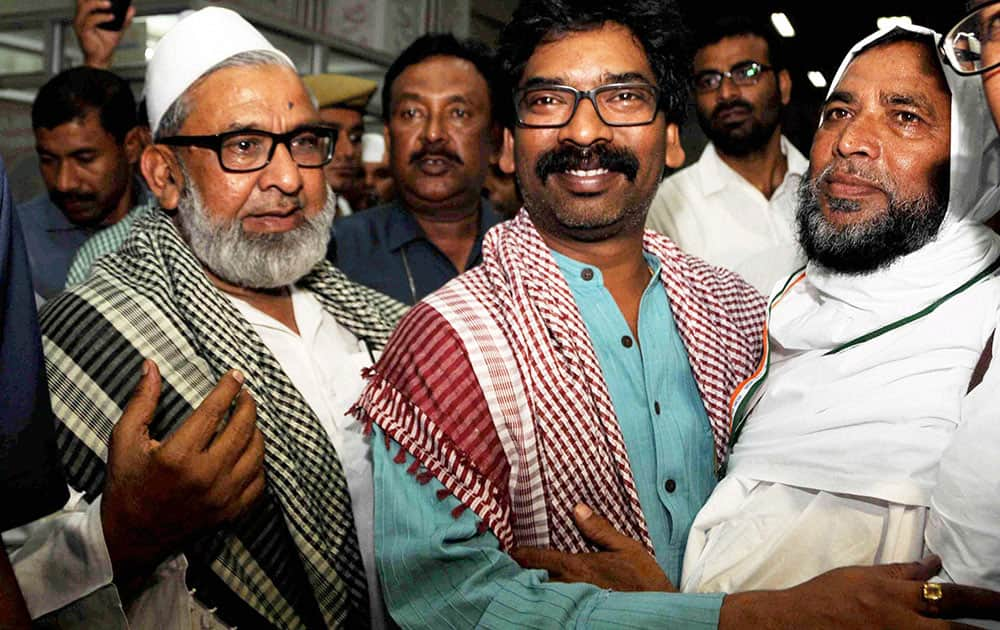 Jharkhand Chief Minister Hemant Soren greets a haj pilgrim while seeing off the first batch of 240 Haj pilgrims from Birsa Munda International airport in Ranchi.