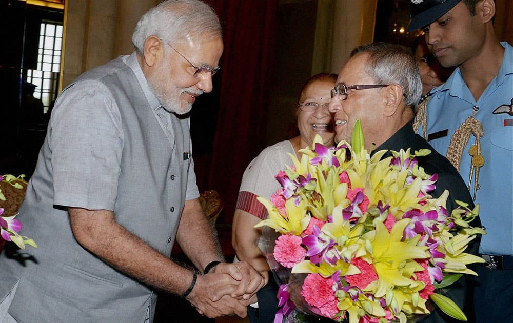 President Pranab Mukherjee is greeted by Prime Minister Narendra Modi on the occasion of his ceremonial departure for the State Visit to Vietnam at Rashtrapati Bhavan in New Delhi.