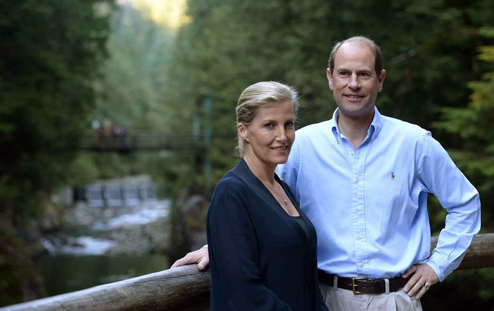 Prince Edward, Earl of Wessex, and his wife Sophie Rhys-Jones, Countess of Wessex, pose for a photo on the TCT Coho River Trail in North Vancouver, British Columbia