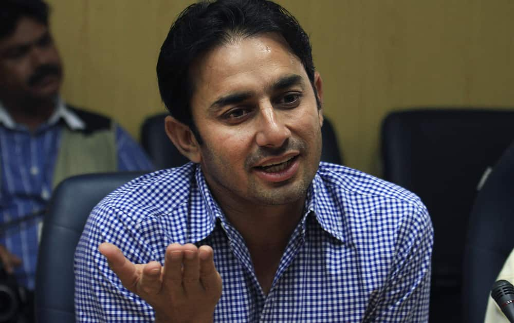 Pakistan's suspended offspinner Saeed Ajmal speaks during a press conference in Lahore, Pakistan. Ajmal said he has overcame disappointment of being suspended from international cricket and hopes to make a strong comeback in next year's World Cup.