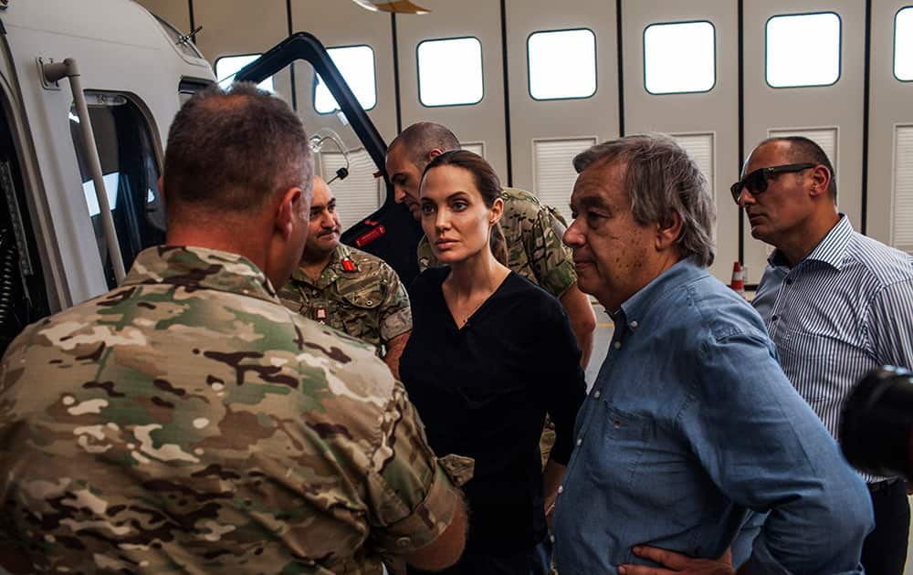 Angelina Jolie, who serves as Special Envoy for the United Nations High Commission for Refugees, listens to officers in the Maltese military discuss rescue at sea operations for refugees at a military base in Valetta, Malta.
