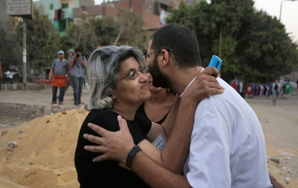 Egypt's most prominent activist, Alaa Abdel-Fattah, is greeted by his mother, Laila Soueif, a university professor who is an also an activist, following his release on bail from Tora prison in Cairo, Egypt.