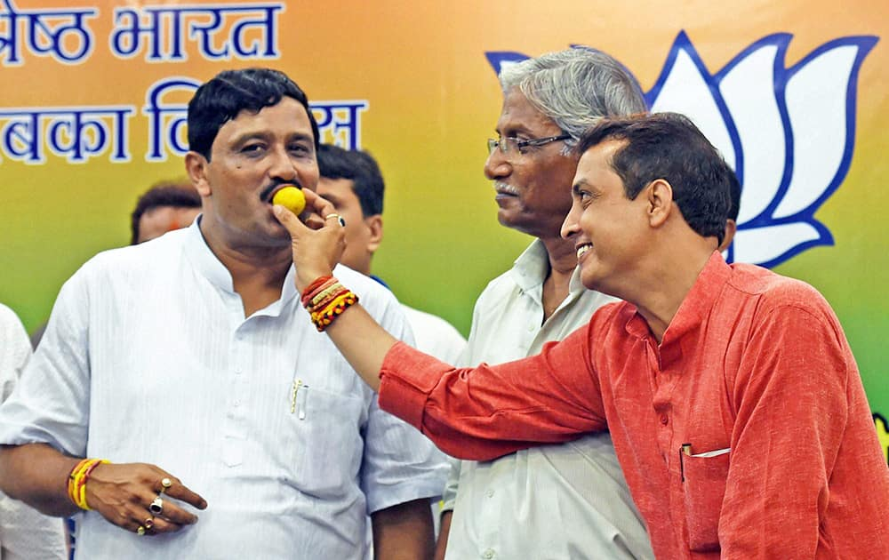 BJP State President Rahul Sinha being offered a laddu after the partys success in the state by-election in Kolkata.