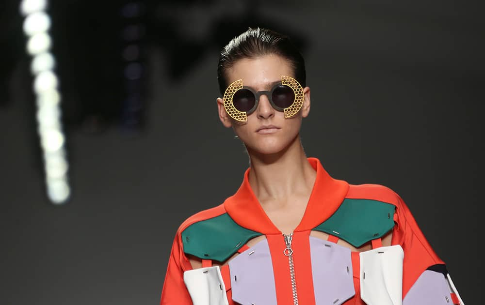 A model wears an outfit by designer H by Hakaan Yildirim for the Spring/Summer 2015 show during London Fashion Week.