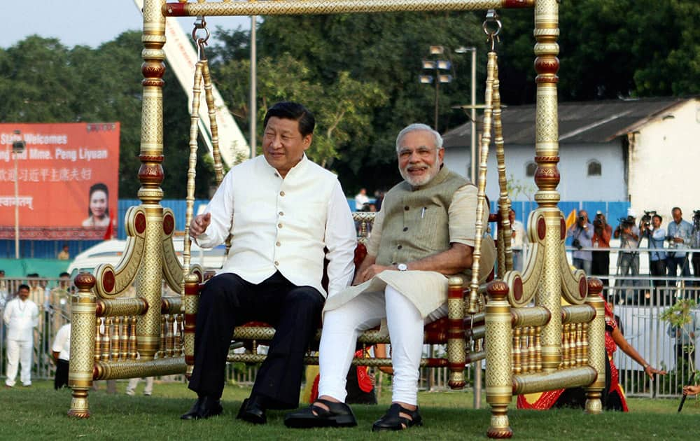 Prime Minister Narendra Modi and Chinese President Xi Jinping sitting on a traditional swing on the Sabarmati River front in Ahmedabad.
