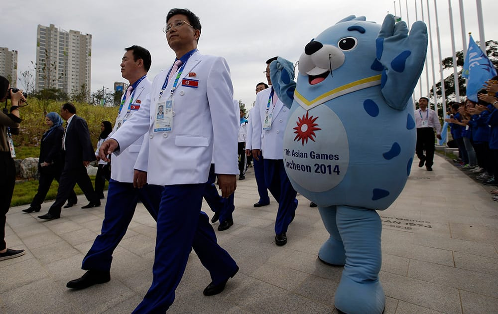 A delegation of North Korean athletes arrive for the welcoming ceremony at the Flag Plaza of the Athlete's Village for the 2014 Incheon Asian Games in Incheon, west of Seoul, South Korea.