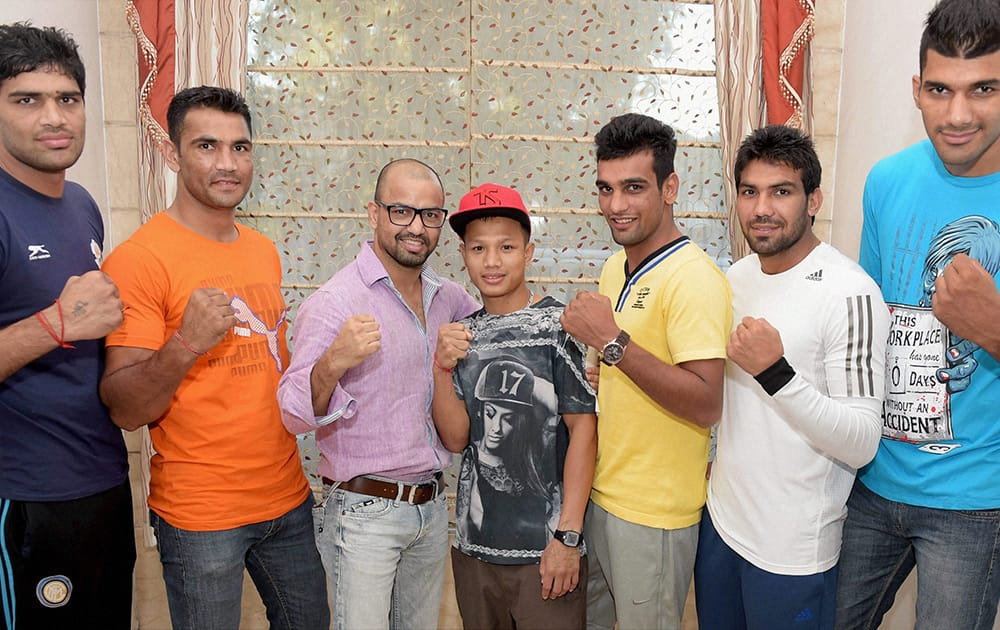 Indian boxing squad, left to right, Satish Kumar, Kuldeep Singh, Akhil Kumar, Devendro Singh, Mandeep Jangra, Manoj Kumar and Amritpreet Singh during a send off ceremony in New Delhi before their departure for Asian Games.