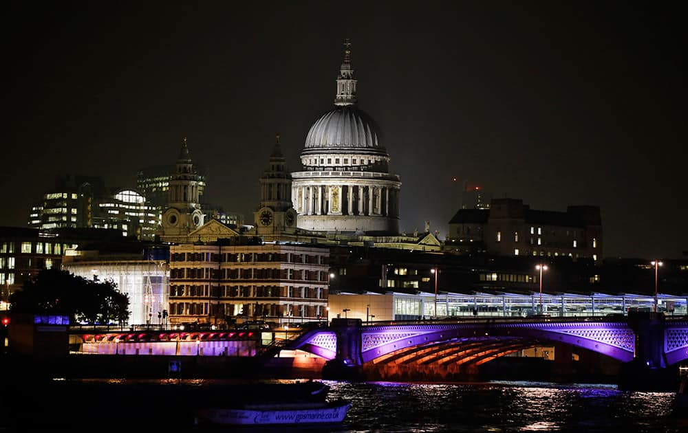 A view of central London's skyline with St Paul's Cathedral from the south bank of the River Thames.