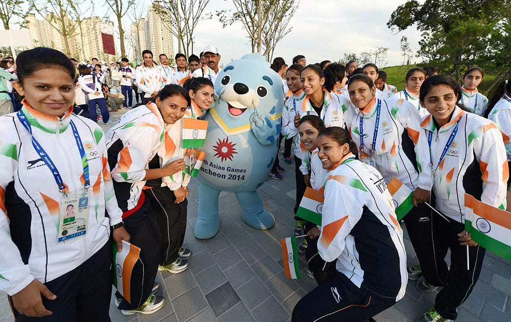 Indian athletes pose with the official mascot of the games during the flag hoisting ceremony of 17th Asian Games in Incheon, South Korea.