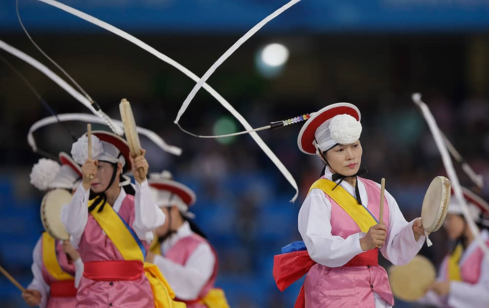 Artists perform during the opening ceremony for the 17th Asian Games in Incheon, South Korea.