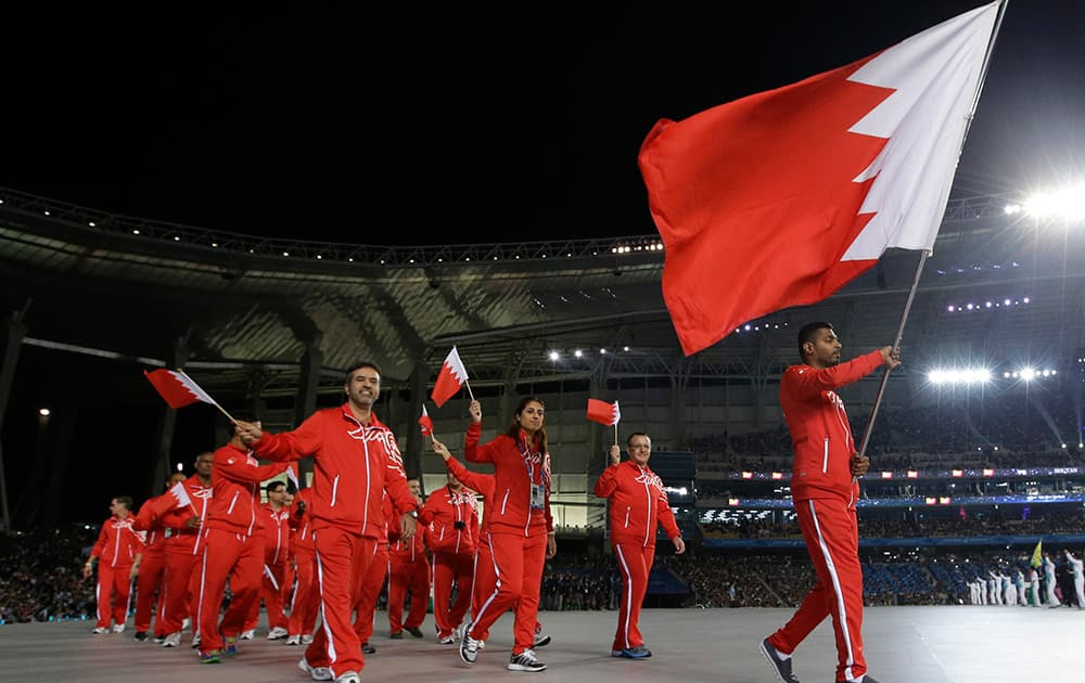 Members of the Bahrain delegation walk into the stadium during the opening ceremony for the 17th Asian Games in Incheon, South Korea.