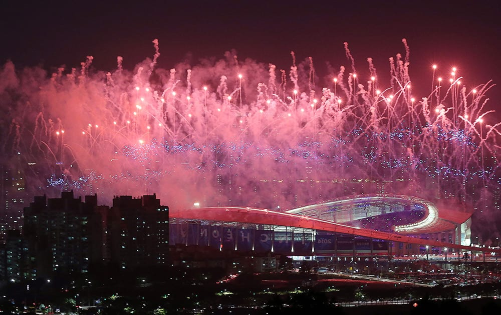 Fireworks explode over Incheon Asiad Main Stadium during the opening ceremony for the 17th Asian Games in Incheon, South Korea.