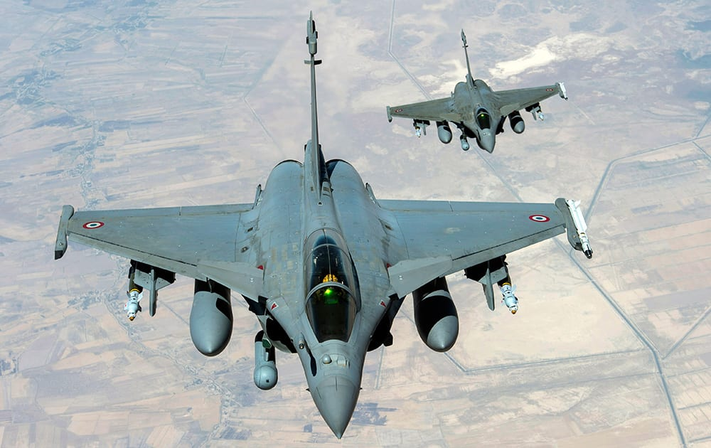 This image provided by the French Army's video and photo department ECPAD shows two Rafale jet fighters flying over Iraq on Friday. Joining US forces acting in Iraqi skies, French fighter jets struck Friday against the militant Islamic State group, destroying a logistics depot, Iraqi and French officials said.