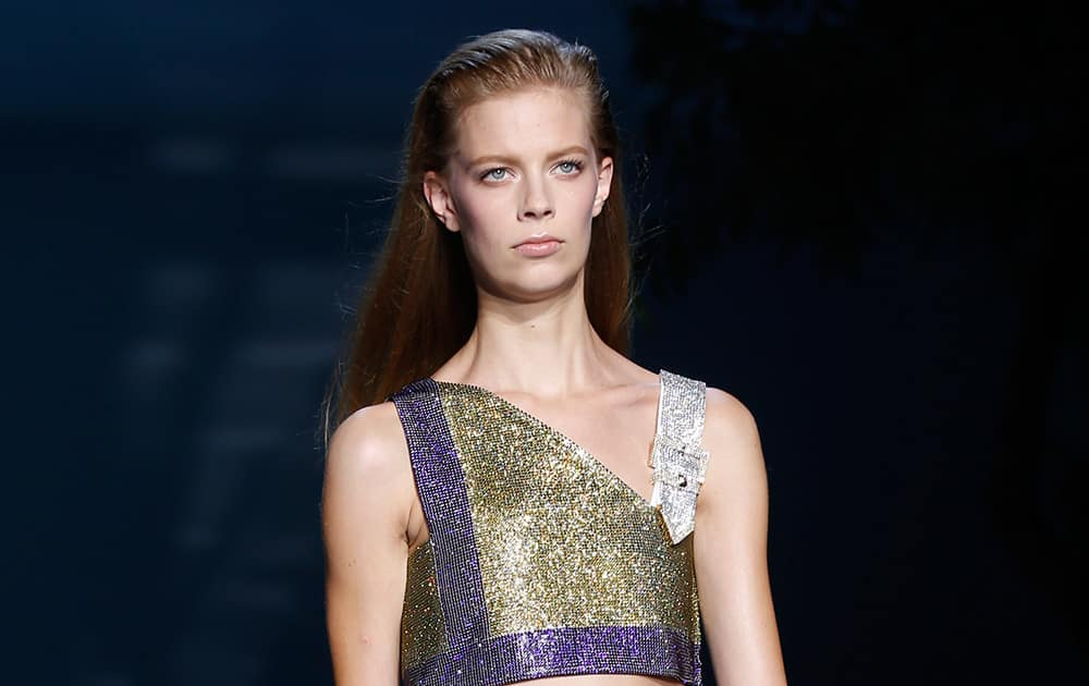 A model wears a creation for Versace women's spring-summer 2015 collection, part of the Milan Fashion Week, unveiled in Milan.