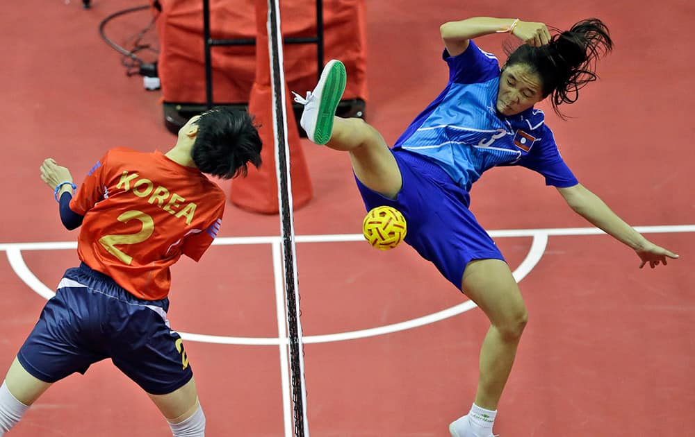 Laos' Koy Xayavong, right, blocks a shot by South Korea's Kim I-seul during their Women's Doubles Preliminary Group A sepak takraw match at the 17th Asian Games in Incheon, South Korea.