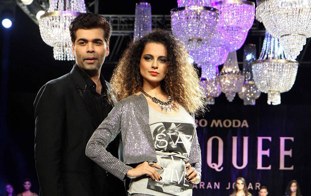 Bollywood filmmaker Karan Johar with actor Kangna Ranaut during the unveiling of Vero Moda collection designed by him in Mumbai.