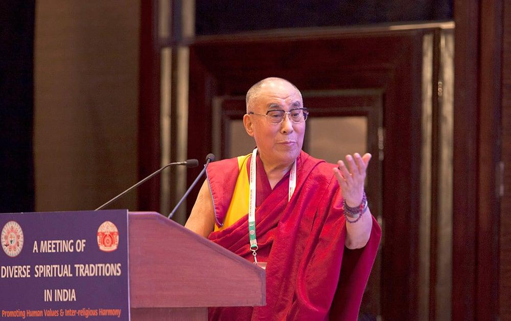 Tibetan spiritual leader the Dalai Lama speaks during an inter-faith meeting in New Delhi.