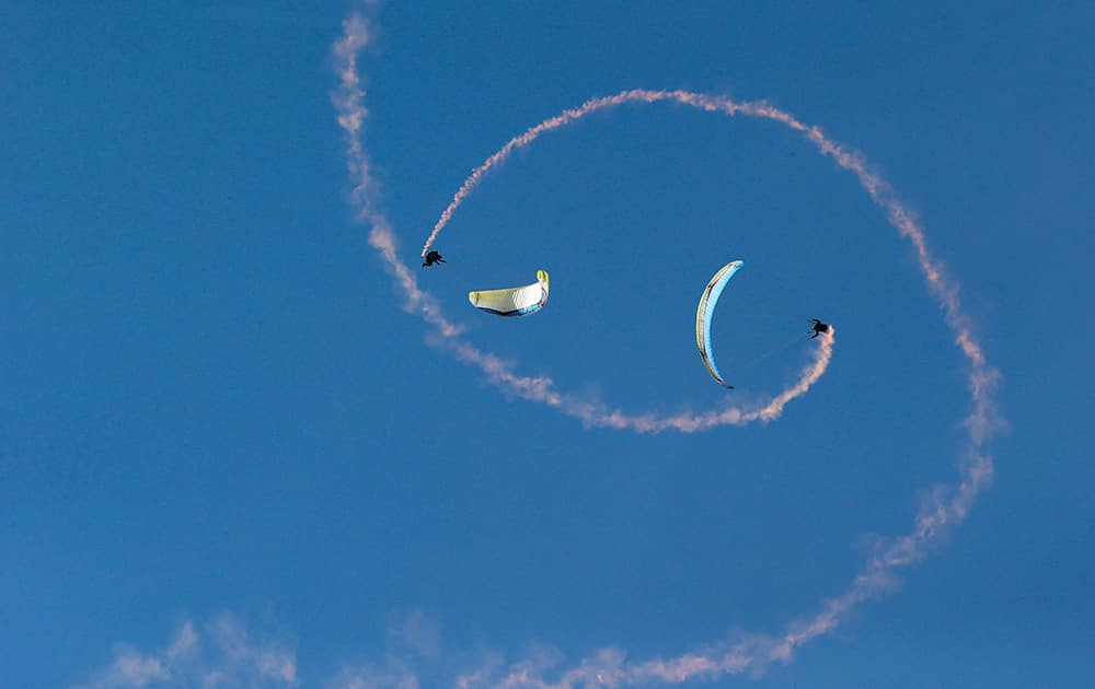 Paragliders perform acrobatic flights during the 41st Icare Cup paragliding festival in Saint Hilaire du Touvet, French Alps.