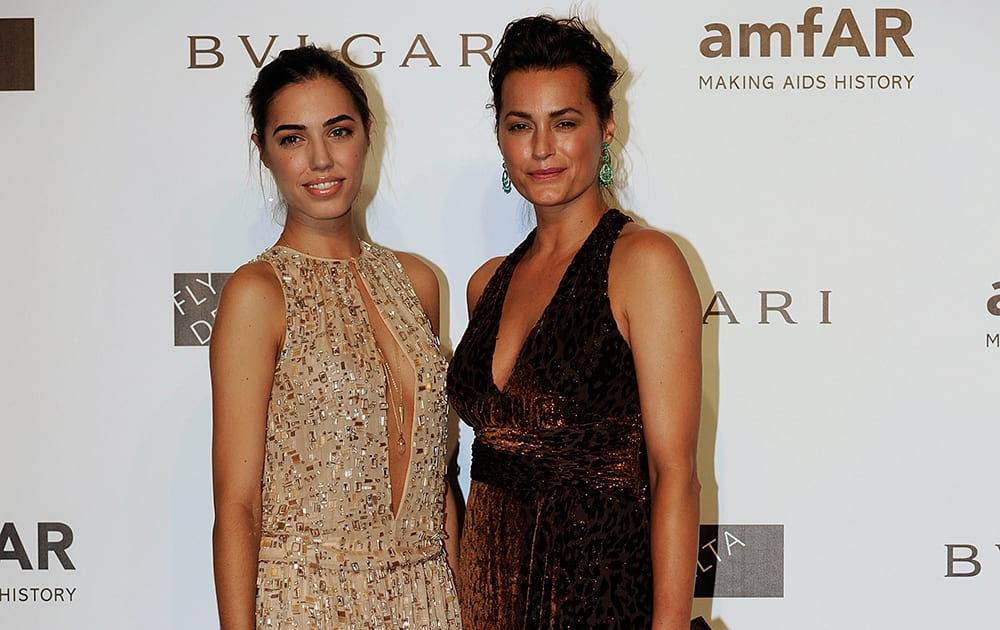 Yasmine Le Bon, left, and Amber Le Bon arrive for the amfAR charity dinner during the fashion week in Milan.