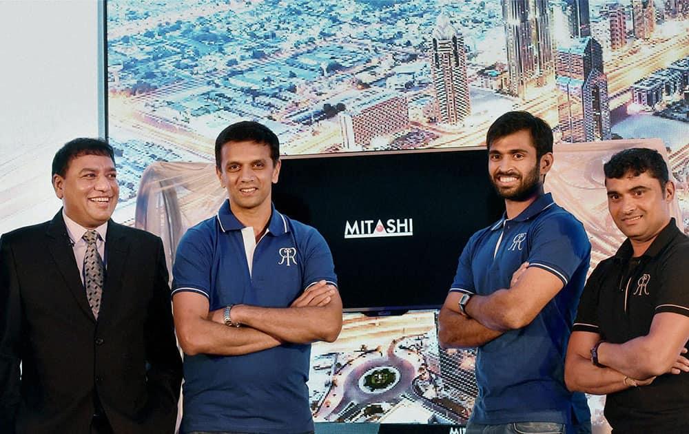 Cricketers Rahul Dravid, Abhishek Nayar and Pravin Tambe with CMD of Mitashi Edutainment, Rakesh Dugar during the unveiling of Mitashis LED TV in Mumbai.