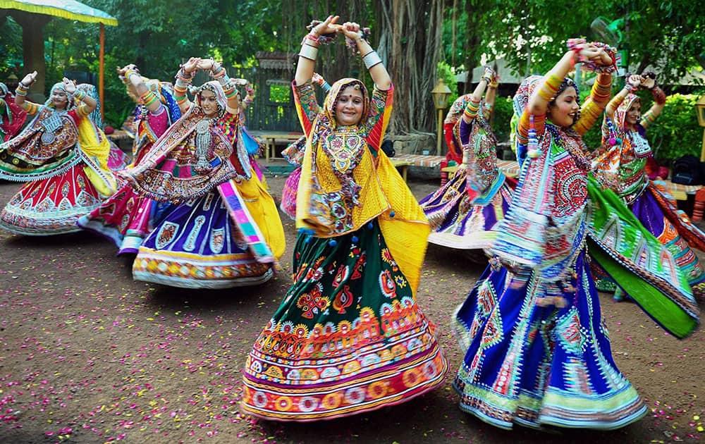 Women clad in traditional ghagra choli practice the Garba dance ahead of Navratri festival in Ahmedabad.