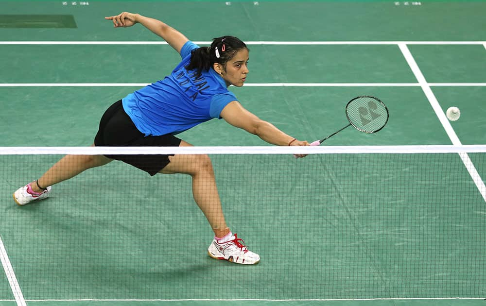 India's Saina Nehwal returns a shot to South Korea's Sung Ji-hyun during the women's Badminton team semifinal match at the 17th Asian Games in Incheon, South Korea.
