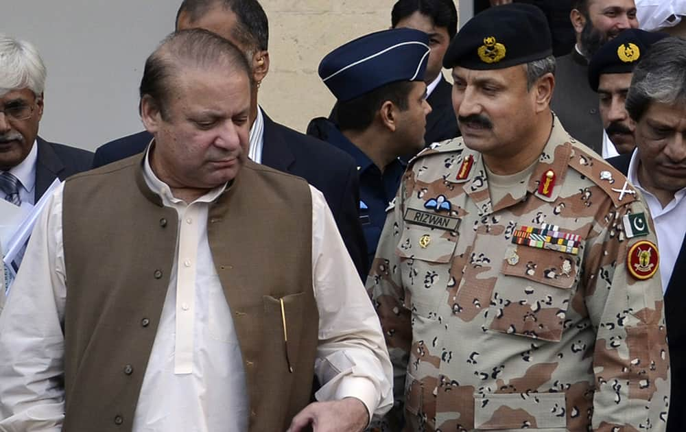 Maj. Gen. Rizwan Akhtar, walks with Prime minister Nawaz Sharif in Karachi, Pakistan. Pakistan's army named a new chief to head the country's premier intelligence agency, the Inter-Services Intelligence Directorate, which is also known by its acronym ISI.