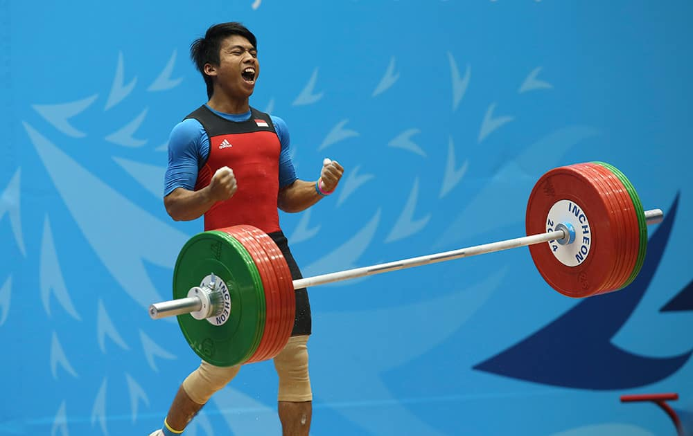 India's Deni reacts after a lift during the men's 69kg weightlifting competition at the 17th Asian Games in Incheon, Korea.