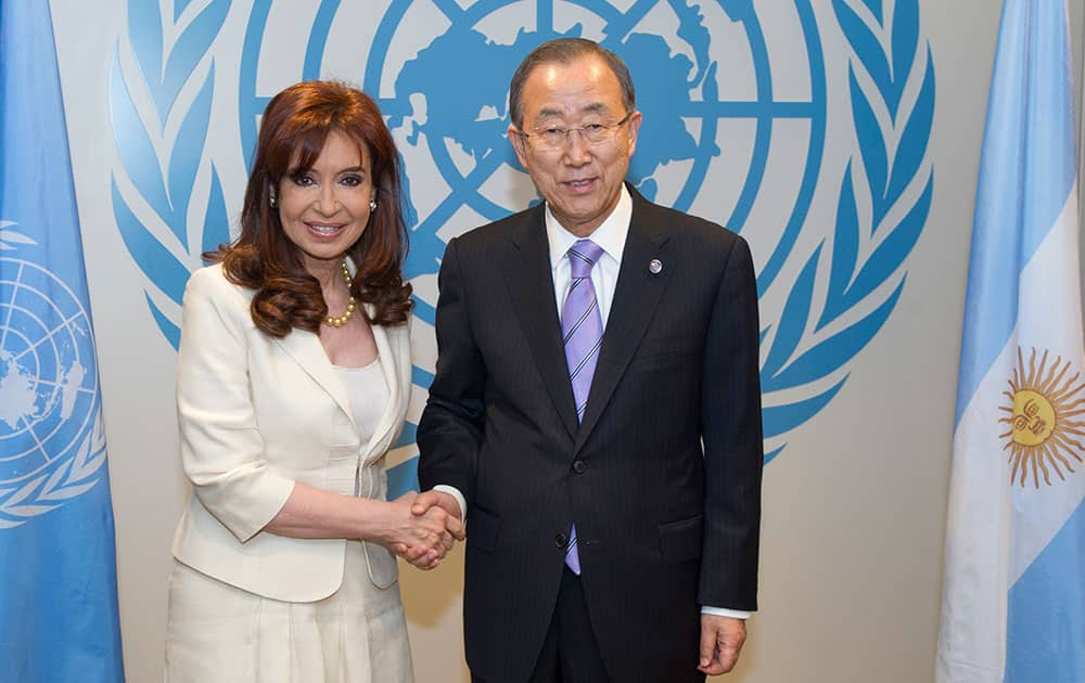 In this photo provided by the United Nations, Secretary-General Ban Ki-moon, right, poses for a handshake with Argentina's President Cristina Fernández, during the 69th session of the United Nations General Assembly at UN headquarters.