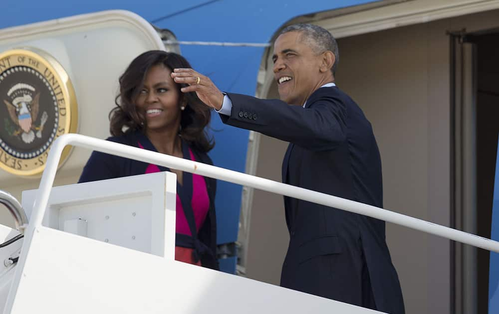 President Barack Obama and first lady Michelle Obama board Air Force One at Andrews Air Force Base, Md. Obama is traveling to New York for three days of talks with foreign leaders at the annual United Nations General Assembly.