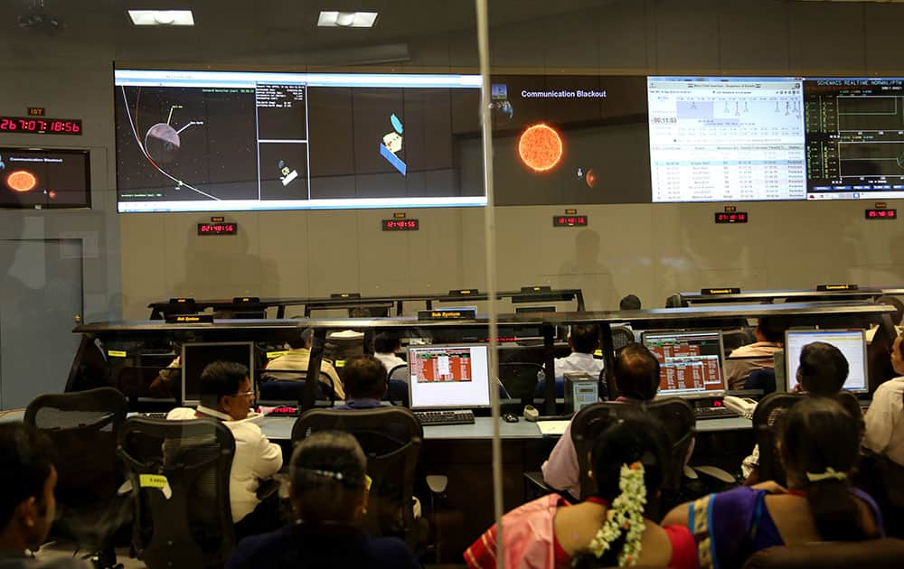 Indian Space Research Organisation scientists watch screens display the graphics explaining Mars Orbiter Mission at their Telemetry, Tracking and Command Network complex in Bangalore.