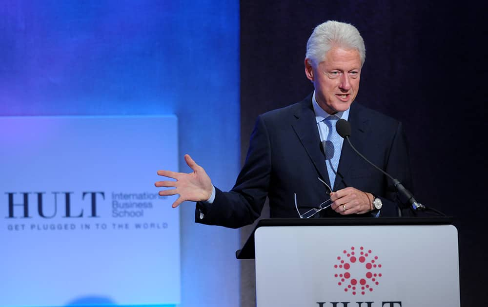 Former President Bill Clinton announces the Hult Prize winner onstage during The Hult Prize Finals and Awards Dinner 2014 at the 10th Clinton Global Initiative Annual Meeting in New York.