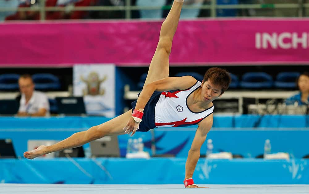 Taiwan's Lee Chih Kai performs during the gymnastics men's floor exercise final at the 17th Asian Games in Incheon, South Korea.