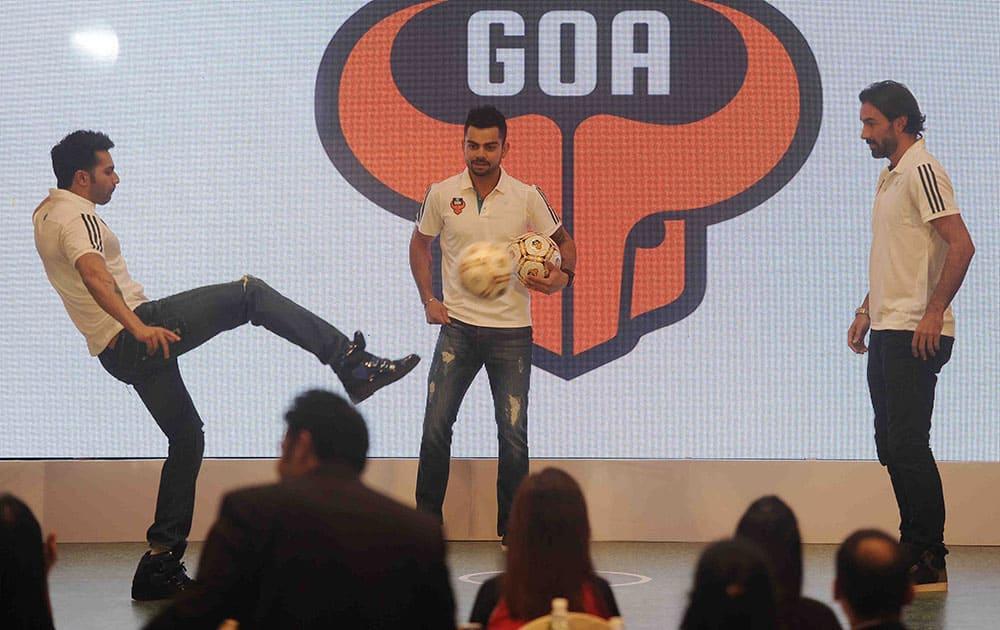 Varun Dhawan (L), Virat Kohli (C) and Robert Pires (R) during the press confrence in Mumbai. dna